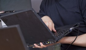 Apex Computer Technician working an a laptop